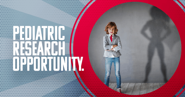Pediatric research opportunity, young boy standing with arms crossed,